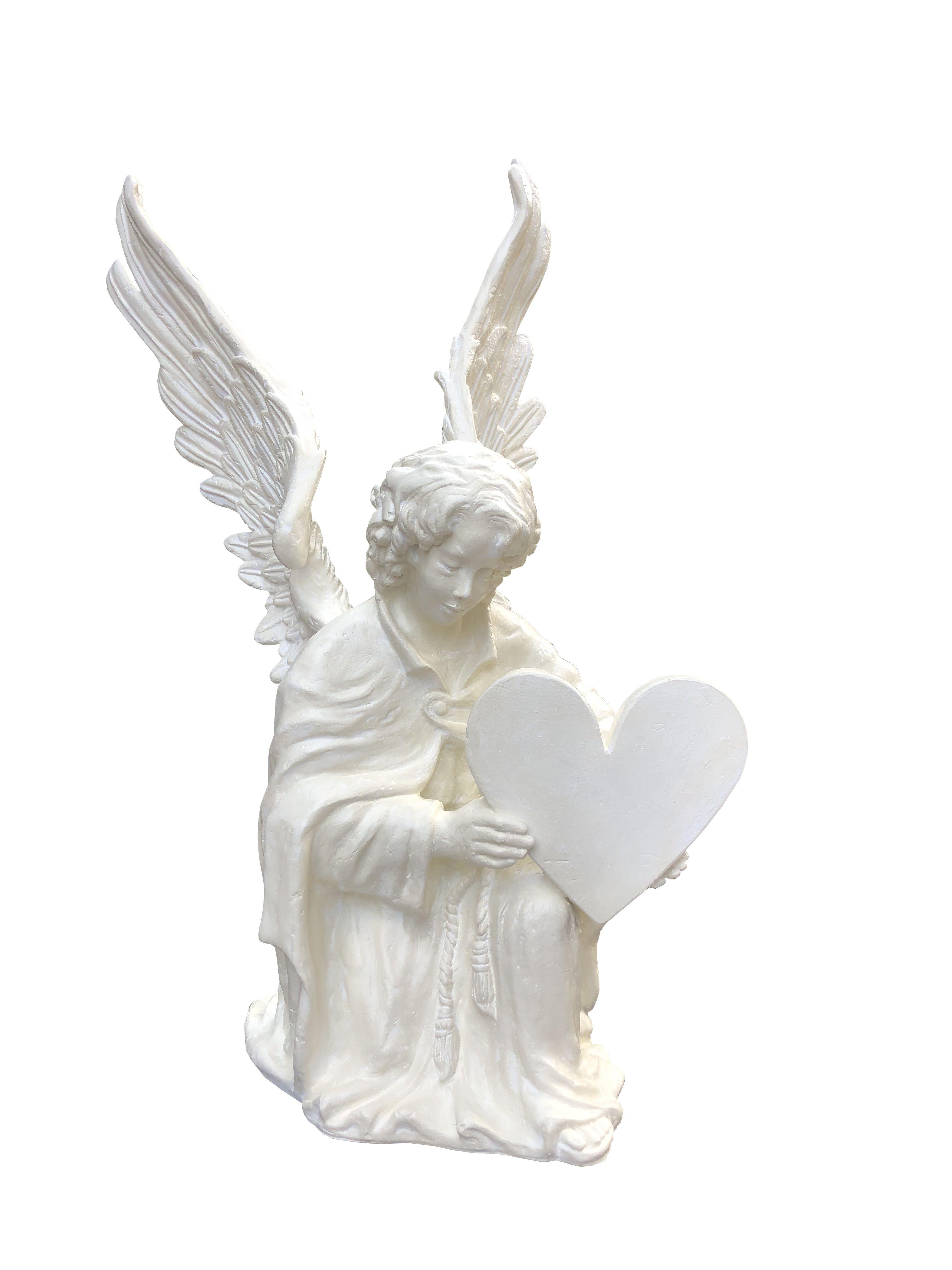 Aniol kleczacy z serduszkiem - rzeźba nagrobkowa